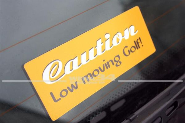 "Aufkleber ""Caution - Low moving Golf"""